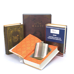group of custom book safes, one with a flask