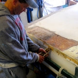 Greg removing screws during the Sandra boat restoration project.