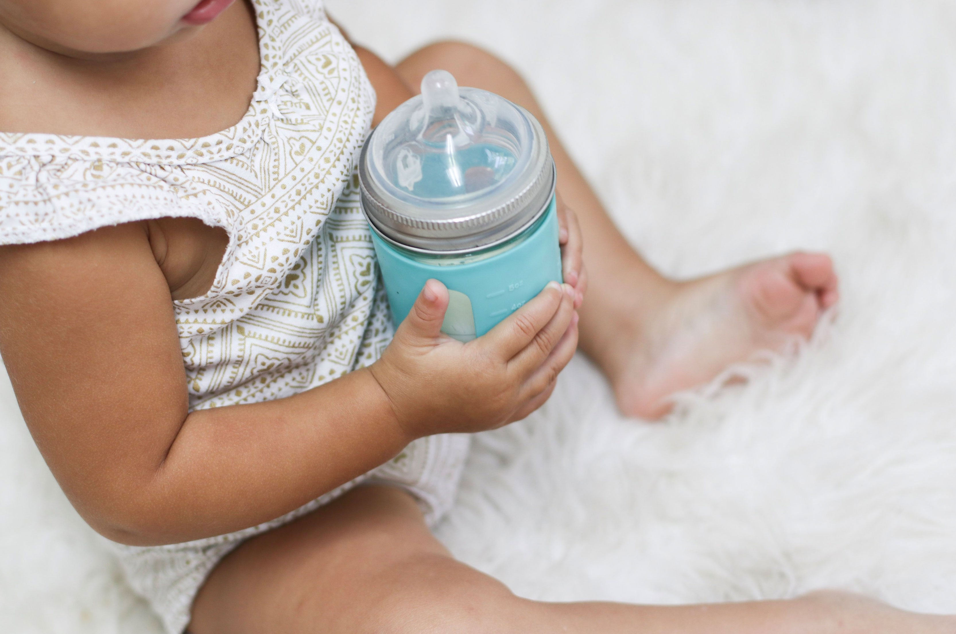 baby holding baby bottle breast milk 8 oz mason jar glass with silicone sleeve wide nipple