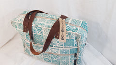 Stowe & so Laptop or Overnight Bag. Morocco design in teal on stone.