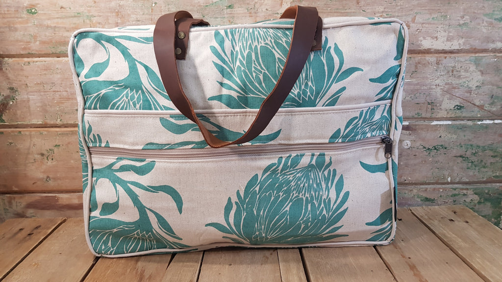 Stowe & so Laptop or Overnight Bag. King Protea in Teal on Stone.