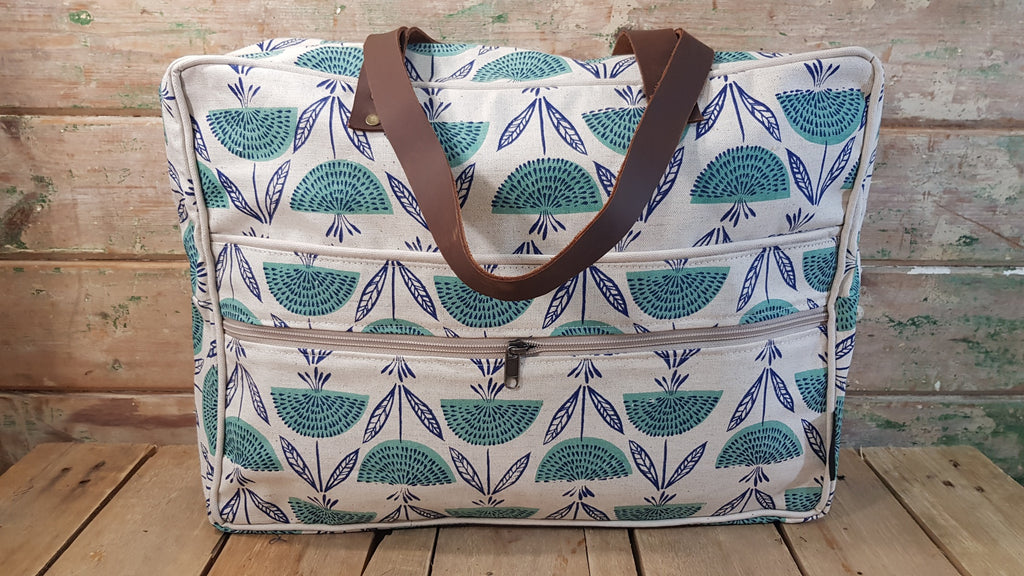 Stowe & so Laptop or Overnight Bag. Watermelon and Dandelion in Blue on Stone.