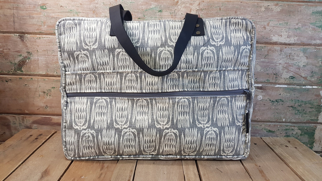 Stowe & so Laptop or Overnight Bag. Protea Repeat in Cream on Light Grey.