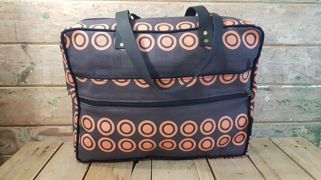 Stowe & so Laptop or Overnight Bag. Sun in Orange on Charcoal.