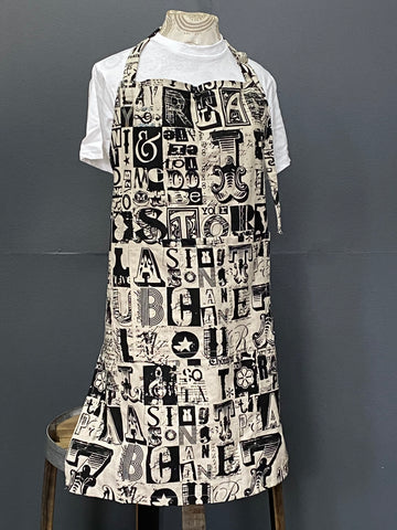 Apron. Letterset in Charcoal on Stone.