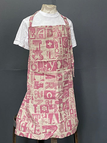 Apron. Letterset in Salmon on Stone.