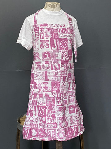 Apron. Letterset in Salmon on White.