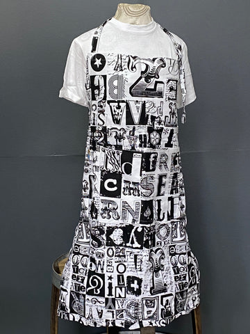 Apron. Letterset in Charcoal on White.