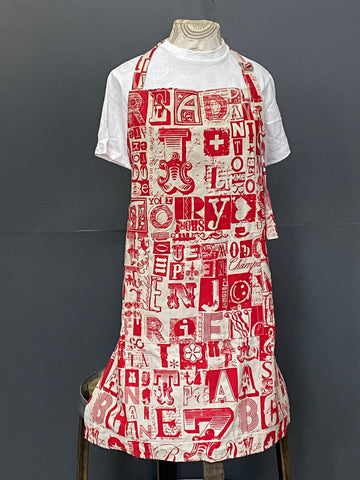 Apron. Letterset in Red on Stone.