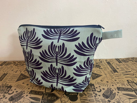 Stowe & so Oversized Toiletry/Cosmetic Bag. Euphorbia in Aubergine on Mint.