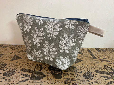 Stowe & so Oversized Toiletry/Cosmetic Bag. Acacia Leaf in White on Grey.