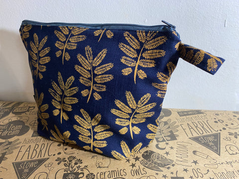Stowe & so Oversized Toiletry/Cosmetic Bag. Acacia Leaf in Mustard on Navy.