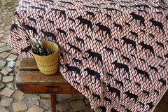 Stowe & so Table Cloth. Animal Abstracts Wild Dog. Black and Brick on Stone.