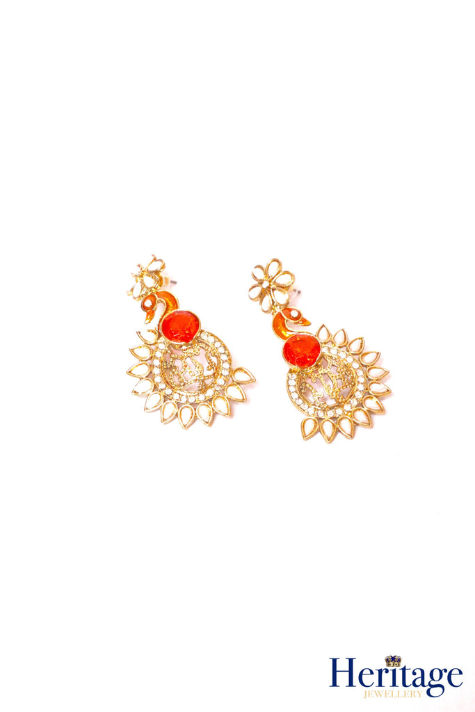 Peacock shaped, antique gold earrings in an orange colour