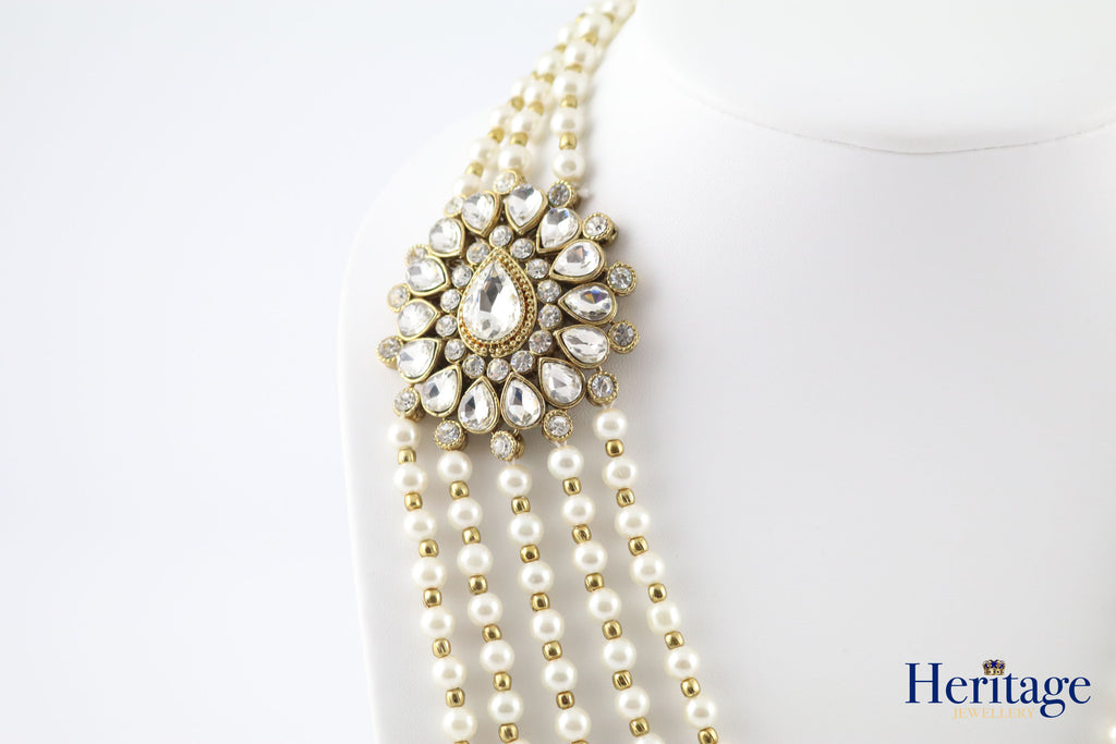 ASYMMETRIC PEARL RANI HAAR WITH WHITE STONE