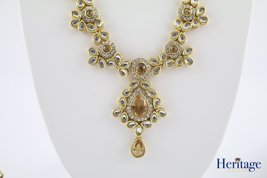 KUNDAN SET WITH GOLD AND WHITE STONE DETAIL