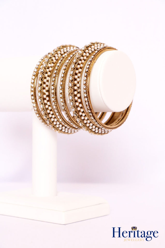Antique Gold Bangles adorned with Pearls and Crystals