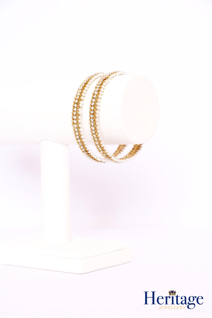 Copy of Antique gold bangles adorned with silver and topaz crystals.