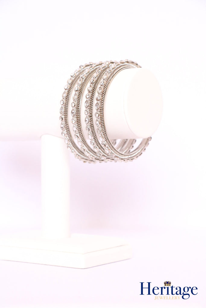 Silver bangles adorned with silver crystals.