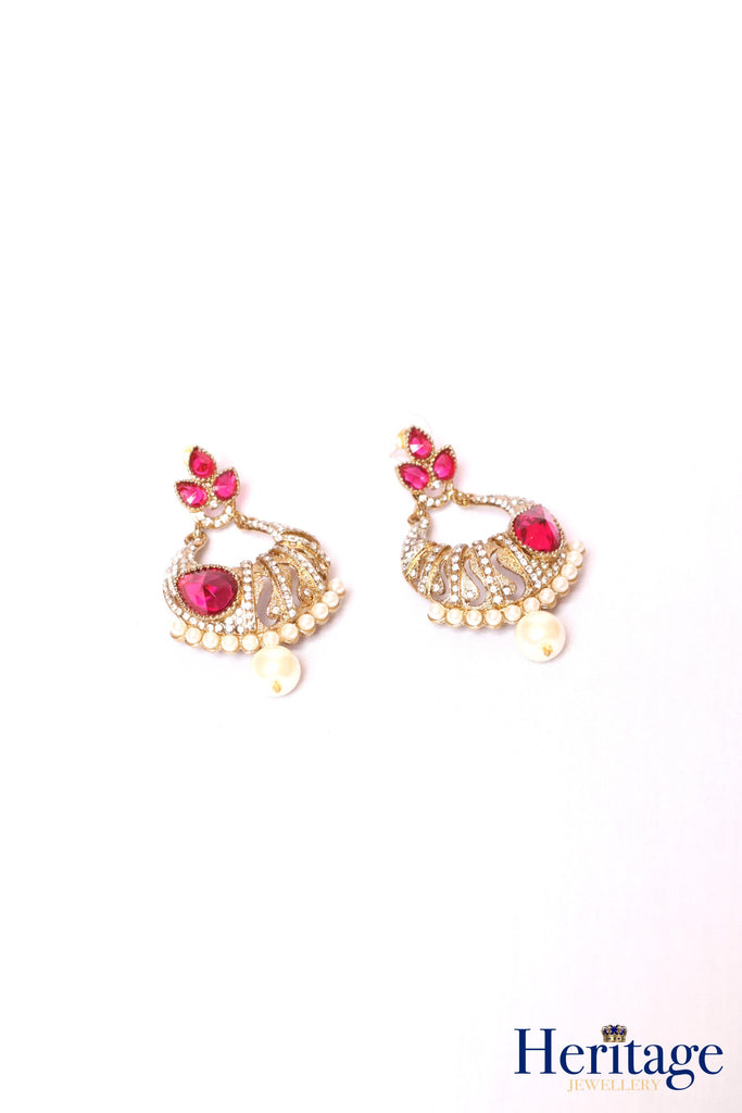 Antique gold drop earrings featuring pearls and silver crystals