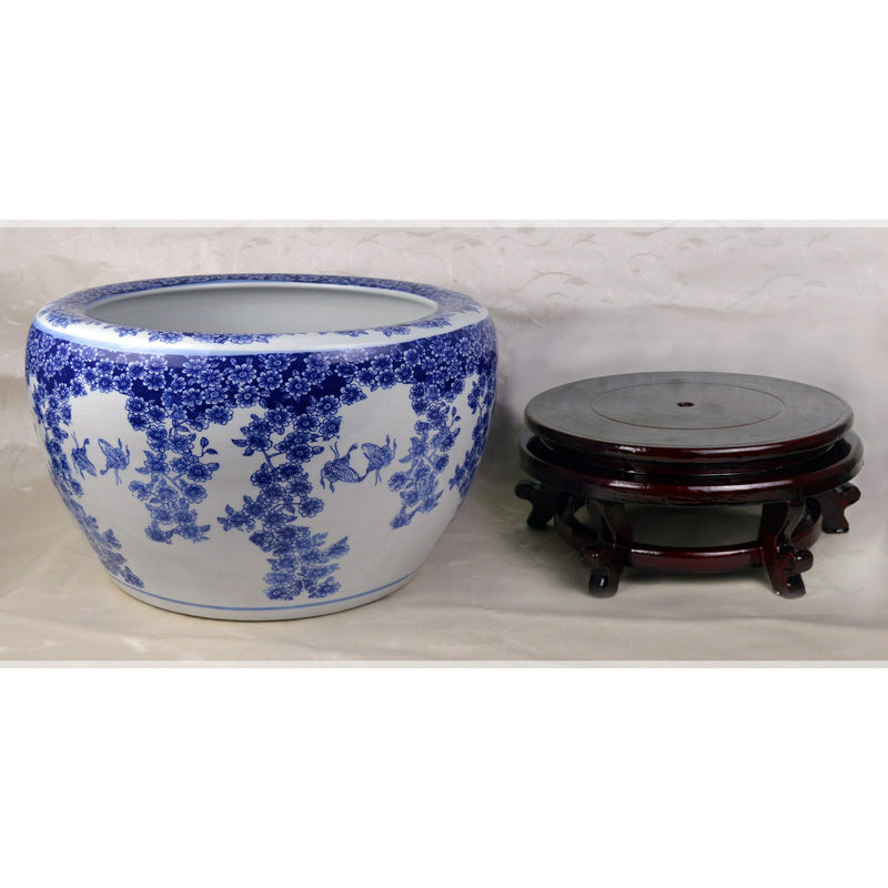 "Fish Bowls - 16"" Diameter Blue And White Porcelain Fish Bowl With Wooden Stand In Floral And Butterfly Motif"