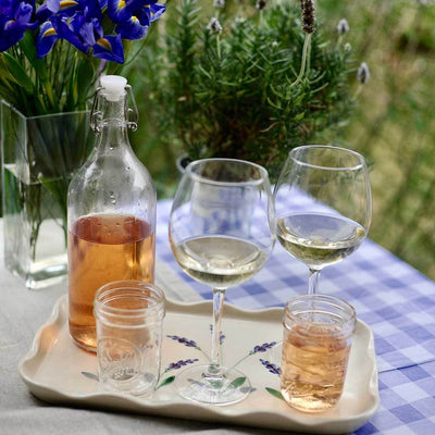 The tray is perfect to serve glasses of rose wine on a bright summer day
