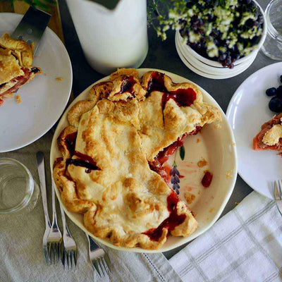 Pie pan and stoneware serveware for pies and desserts at picnics and potluck parties