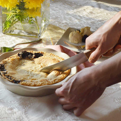 Blueberry Pie being Cut Into in Stoneware 9 Inch Pie Pan with Lavender Design Made In USA