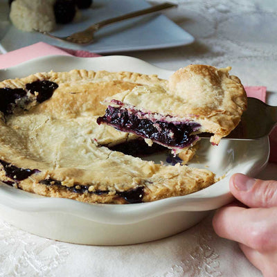 Blueberry Pie Being Served From Stoneware 9 Inch Pie Pan with Lavender Design Made In USA