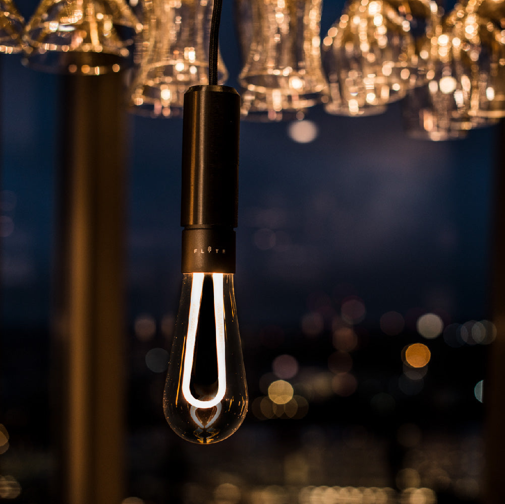 Arc LED light bulb hanging in restaurant