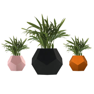 3 levitating planters, pots in a row with black, pink, terracota silicone skin
