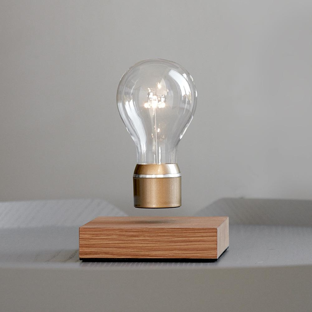 Lifestyle image of FLYTE Levitating light bulb Royal on gray background