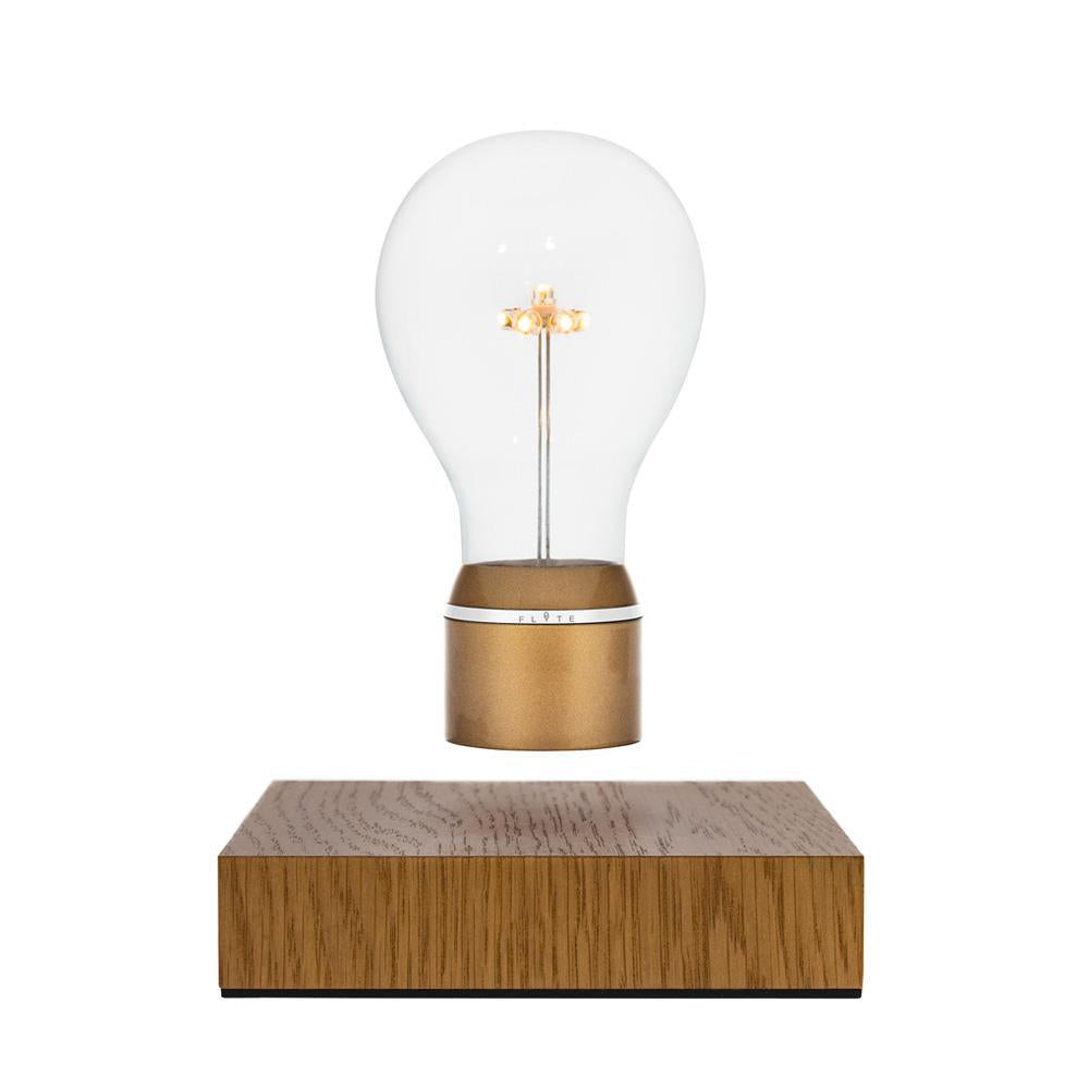 Levitating light bulb FLYTE Royal is our Oak edition and one of our best sellers. Royal features an Edison style borosilicate glass bulb, a 7 LED star-shaped filament, a Gold cap and an aluminum ring. The base is crafted from a sustainably-sourced Oak wood.