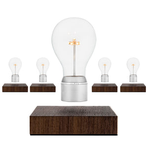 Levitating light bulb Inspired by New York City's monochrome skyline, Manhattan features an Edison style borosilicate glass bulb, a 7 LED star-shaped filament, a Chrome cap and an aluminum ring. The base is crafted from a sustainably-sourced Walnut wood.