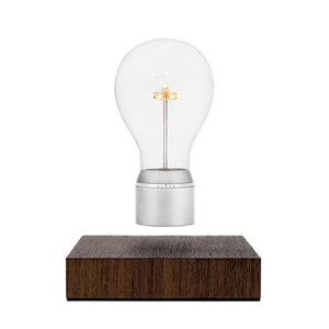 Inspired by New York City's monochrome skyline, Manhattan features an Edison style borosilicate glass bulb, a 7 LED star-shaped filament, a Chrome cap and an aluminum ring. The base is crafted from a sustainably-sourced Walnut wood.