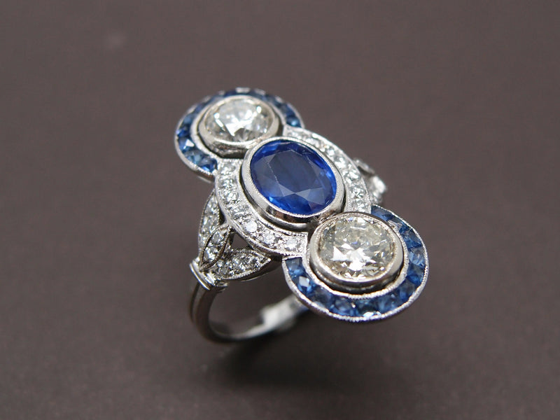 Bague Saphir , diamants et saphirs calibrés