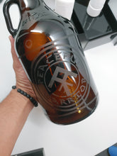 Load image into Gallery viewer, PEACEMAKER BRAND / PEACEFUL WARRIOR 64 OZ. AMBER GLASS GROWLER