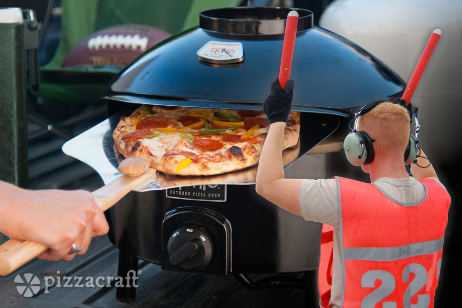 Guiding your pizza into your pizza oven