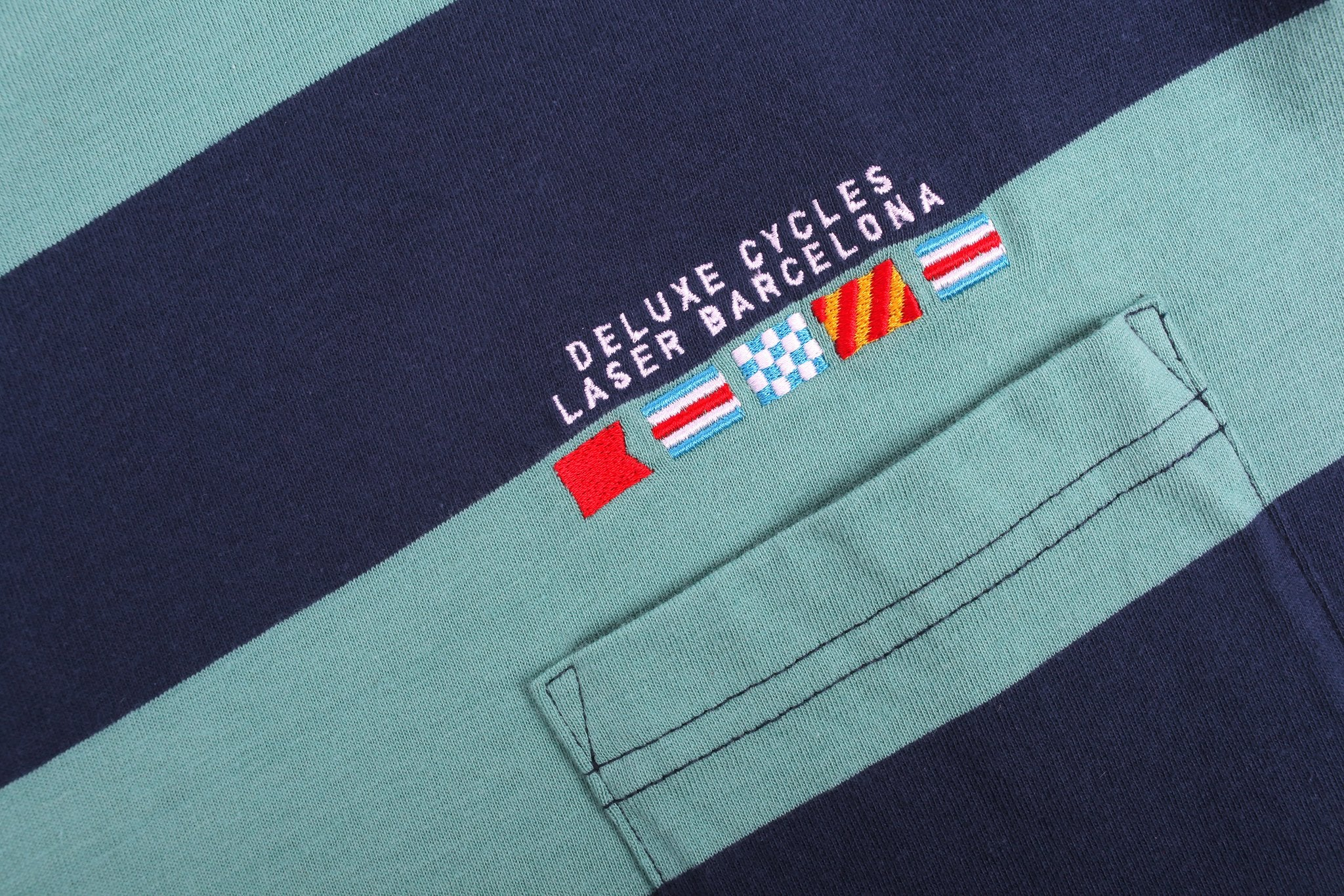 Laser Barcelona x Deluxe Cycles - CITY FLAGS WOVEN POCKET TEE  - SEAWEED