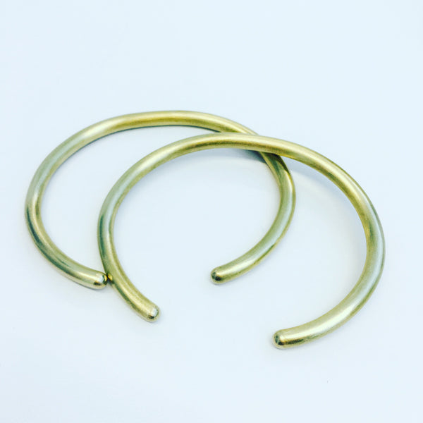 Pair of brass cuffs: Medium