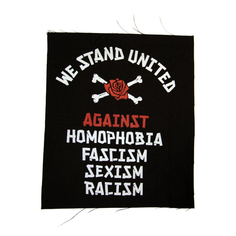 "Black cloth patch with the words ""We Stand United"" in white text in an arch above a pair of white crossed bones with the Timbers Army rose in the center of crossed bones. Beneath is the word ""Against"" in red text with the words ""Homophobia, Fascism, Sexism, Racism"" in white text."