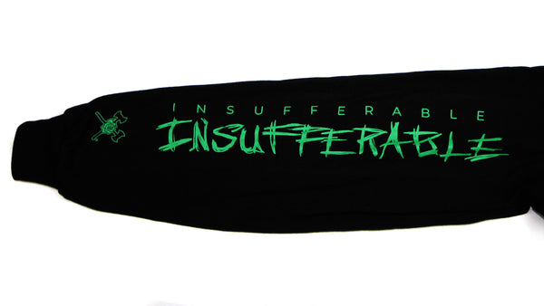 "A detail of the right sleeve with the word ""Insufferable"" twice down the length of it. The first instance is in green block letters. The second instance is in a larger, hand-drawn typeface in green letters. Near the cuff of the sleeve is the Timbers Army crossed axes and rose logo in green."