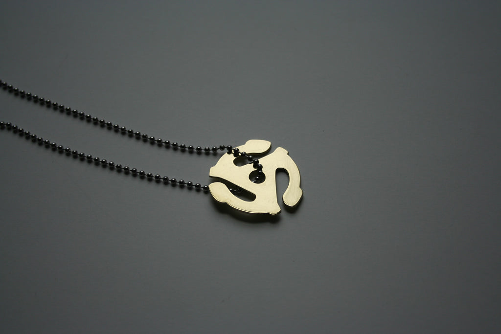 45 adapter necklace in brass