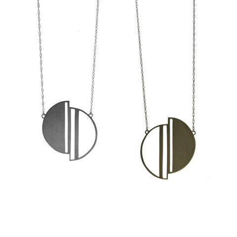 Geometric design of Half Moon necklace