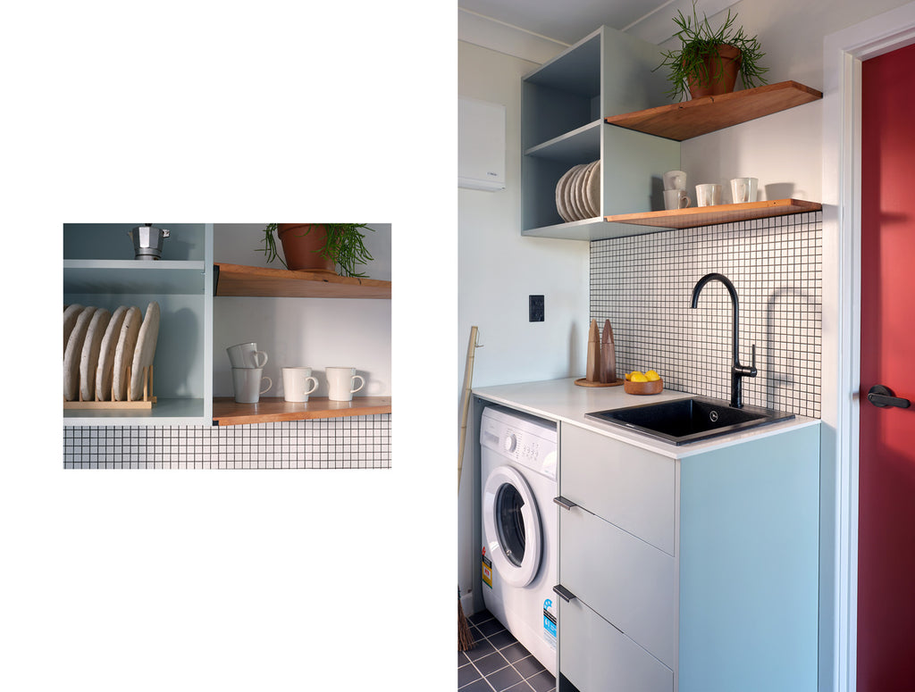 Kitchen of the small apartment with wooden shelves