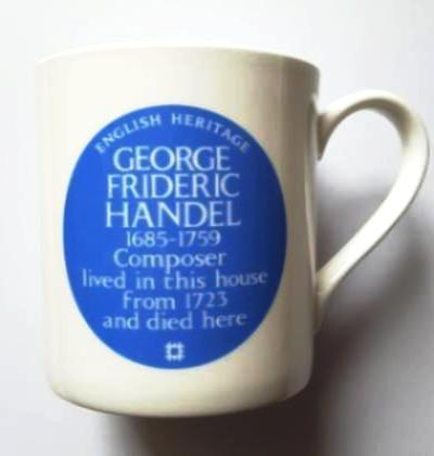 "white mug featuring a blue oval description with the words ""English Heritage, George Frideric Handel, 1685-1759, Composer lived in this house from 1723 and died here"""