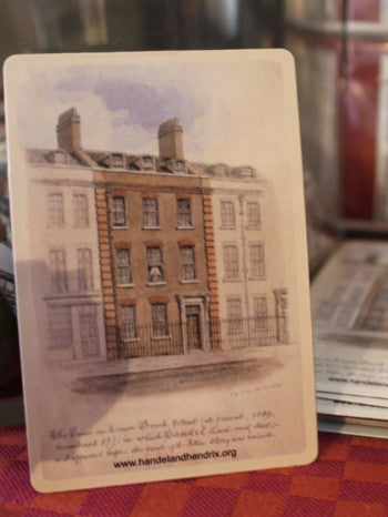a rectangular magnet featuring a watercolour sketch of 25 Brook Street with cursive text at bottom from Buckler himself.