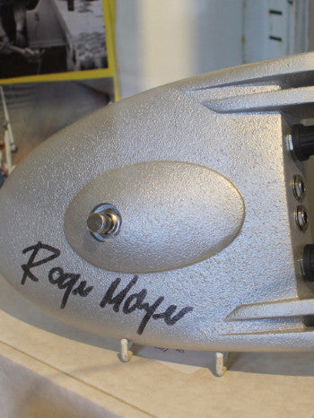 a close up of the grey guitar pedal featuring Roger Mayer's signature in black permanent marker