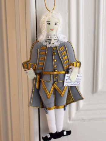 full body image of felt Handel hanging decoration wearing a white wig, a blue and gold Georgian costume, holding a musical score