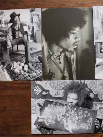 a close up of a flat lay of 4 postcards featuring various photos of Hendrix